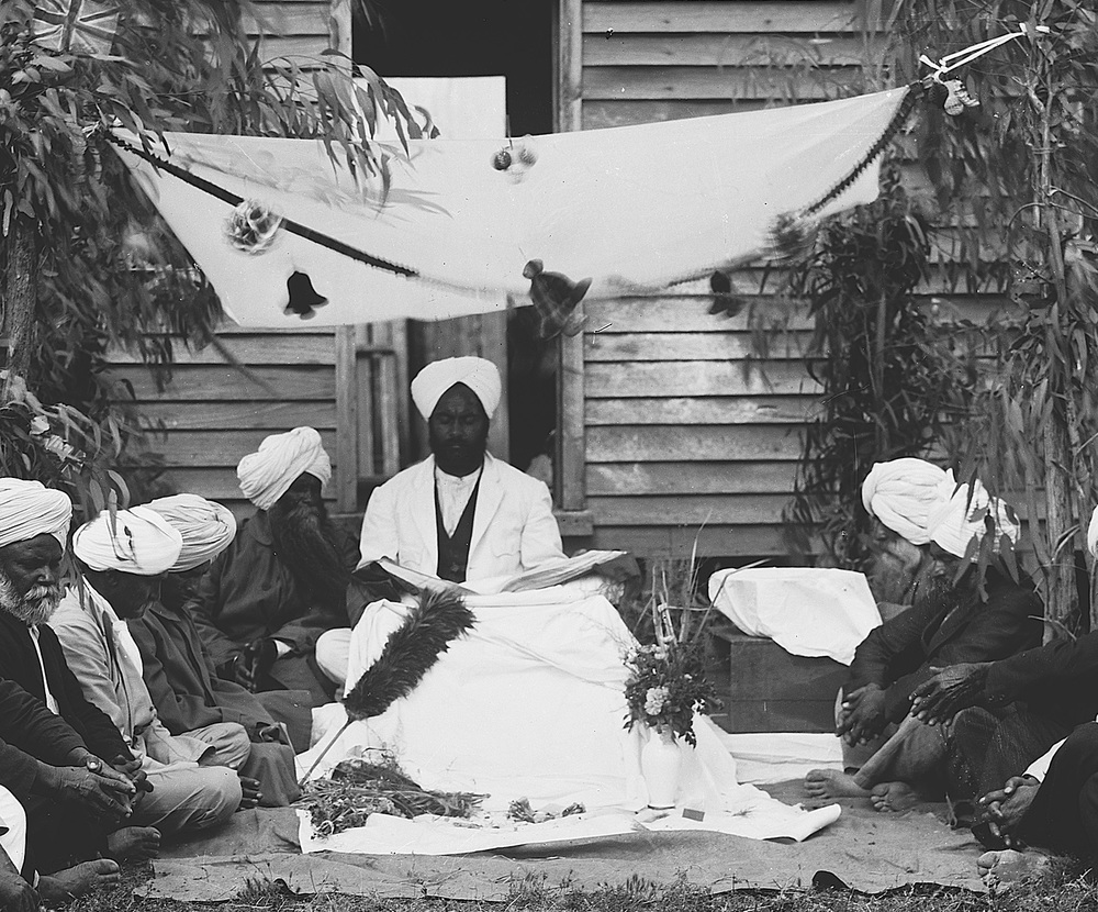 "Reference: Close up of above image, ""A group of Indian men, possibly Sikhs, outside a timber cottage at Reef Hills near Benalla,"" W. J. Howship collection, University of Melbourne Archives, 1988.0137.00704"