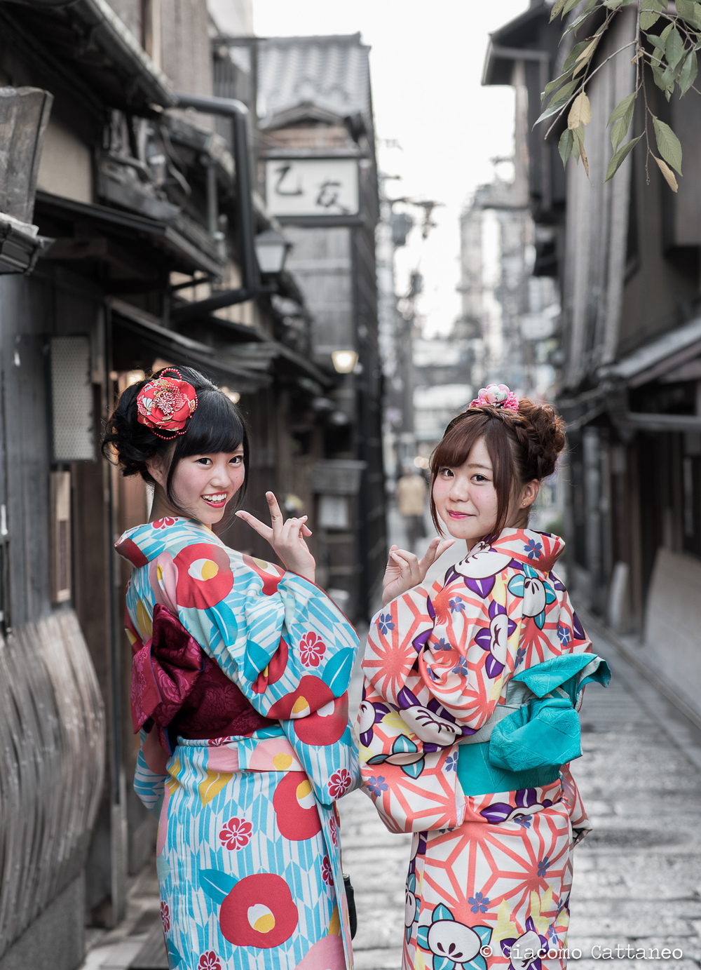 ISO 400, 85mm, f/4.0, 1/60 sec - Kyoto. My favourite tourists! It's customary for Japanese girls who visit Kyoto to take out their brightest kimonos and stroll the streets in such a fashion. So they first asked me if I could take a picture of them, and then asked them if I could do the same with my camera. Picture-wise, shooting with an 85mm is such a joy for portraits, as the foreground and background collapse much closer, and the effect on people's features is much more flattering. I also unsaturated the background, so to have their kimonos stand out even more.