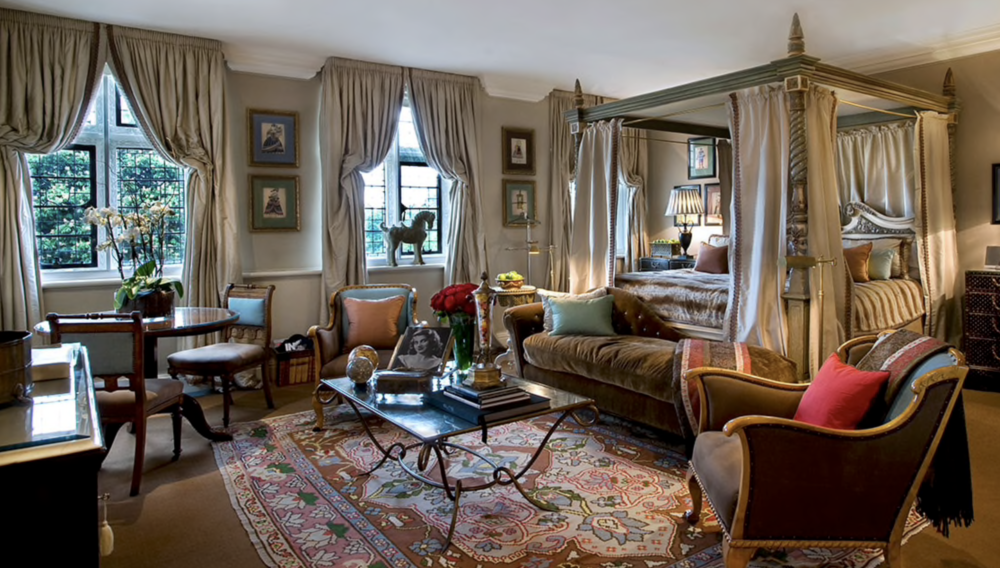The Viscount suite. Mrs. Tollman sources much of the interior design elements at local antique stores and markets in Europe. Note the chairs covered in blue which she repeats in the artwork and crown of the bed.