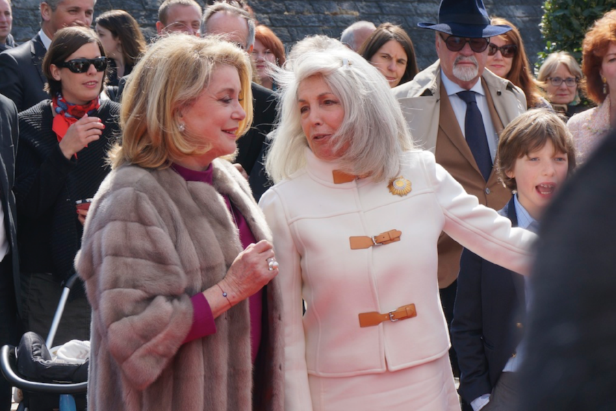 Bea Tollman, right, wearing a signature broach, tailored jacket, talking with Catherine Deneuve in France.  Image credit Ralph Grizzle