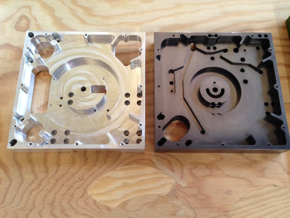 Our previous A/B backing plates(required) required the wires to be routed through the center where they could get kinked and made it impossible to disassemble if repair was needed.  The new plates(left) have the wires routed through the side and includes a second motor for additional torque.