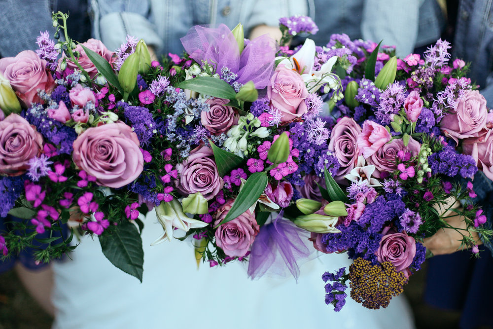 Deep shades of purple complemented this bride's style for her September wedding.