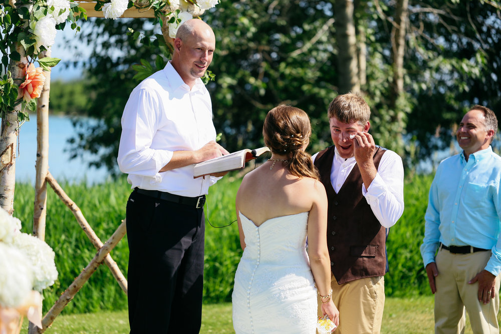Joe was teary as he gazed at his new wife, Melanie, during their Kalispell wedding.