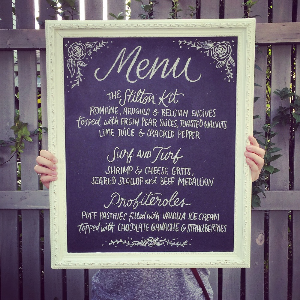 Hand lettering chalkboard for Ouisie's Table in Houston, TX