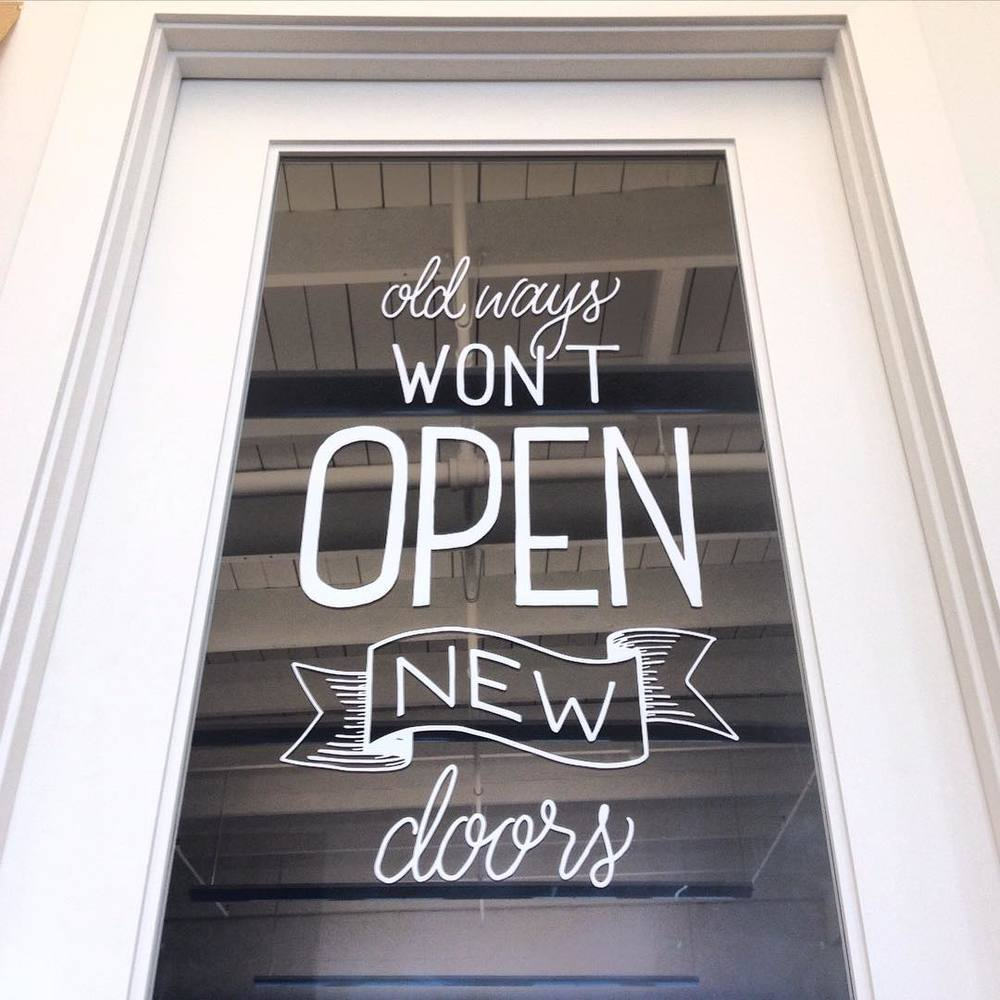 Hand lettering window vinyl for The Black Sheep Agency in Houston, TX