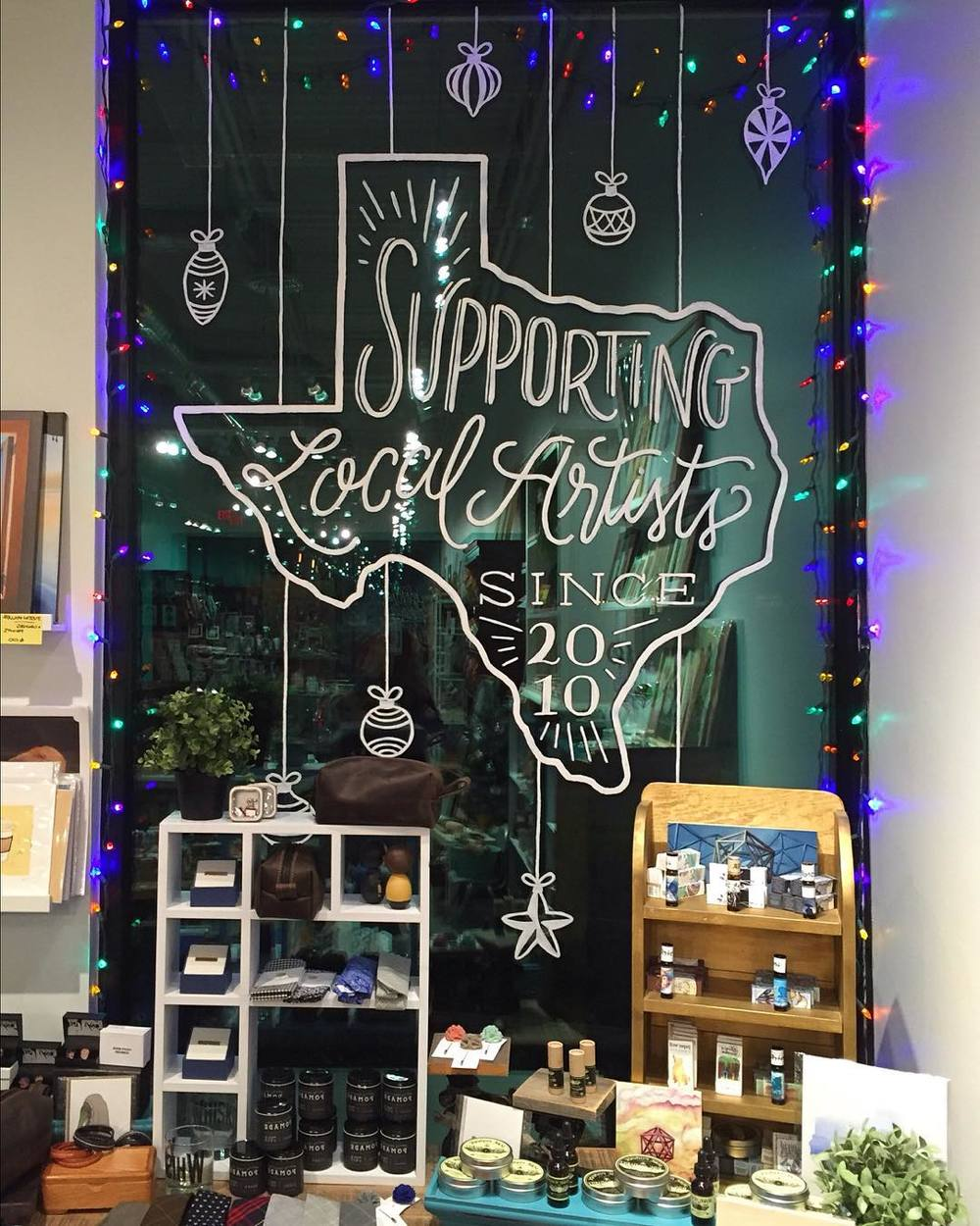 Hand painted lettering for Space Montrose holiday windows in Houston, TX