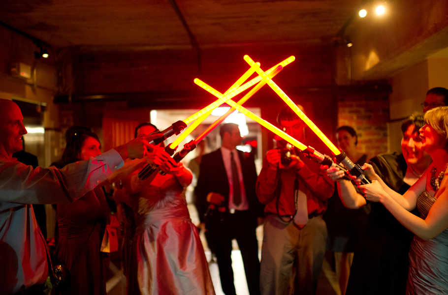 People always warn you about how fast your wedding day will go, and they aren't kidding.  Here's our exit through the light sabers. (You have to let the geeks make decisions too.)