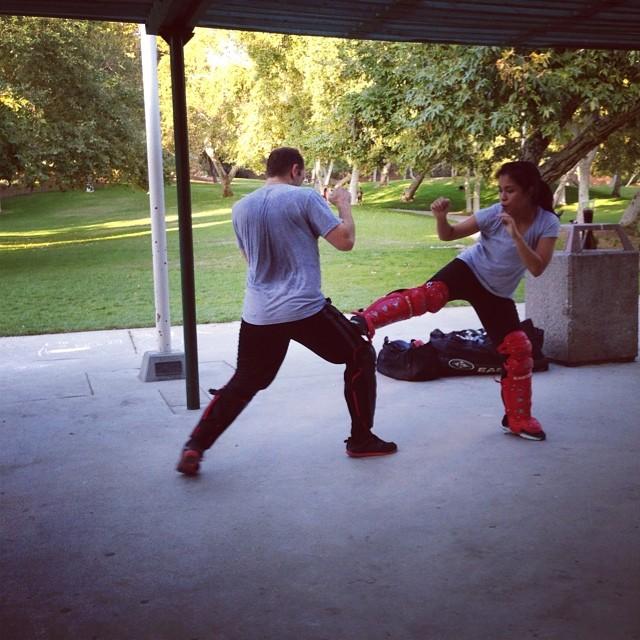 Jazmin stops Jason in his tracks with a #jkd leg obstruction...& sets up for the rear #muaythai round kick. #silat #kali #jujitsu #combatives #mma #training #burbank