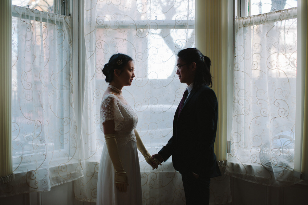 008-Couple-Wedding-Portrait-Window-Holding-Hands-Glasgow-Tenement.jpg