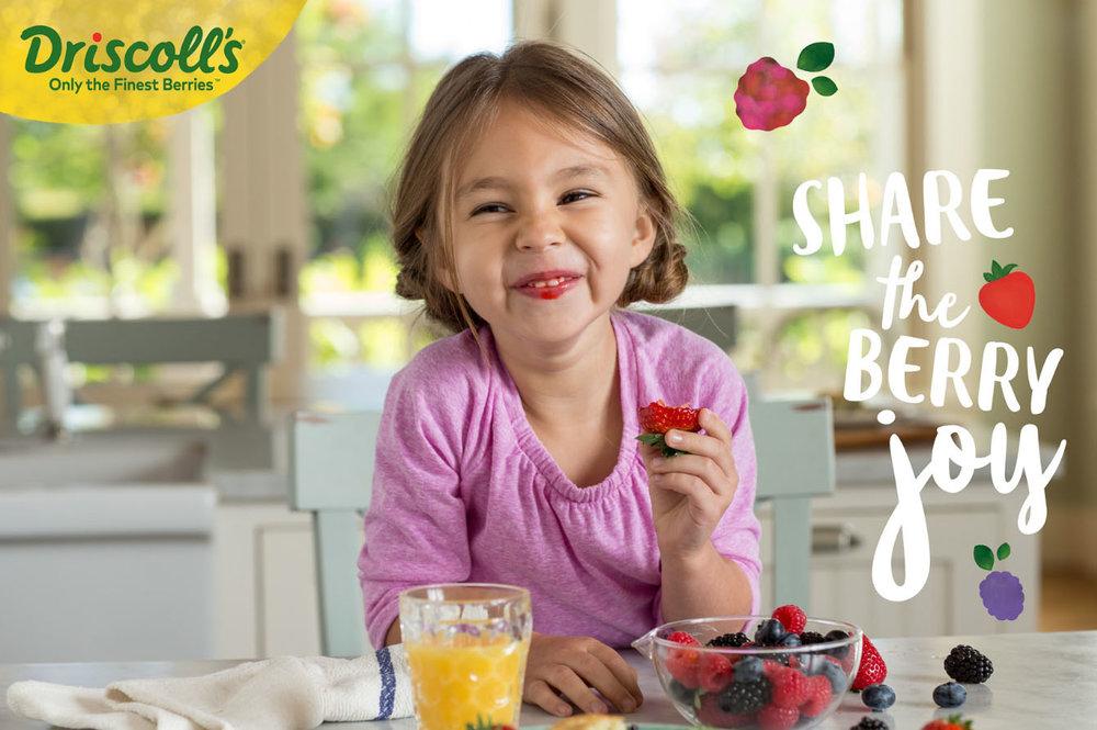Driscolls share a berry.jpg