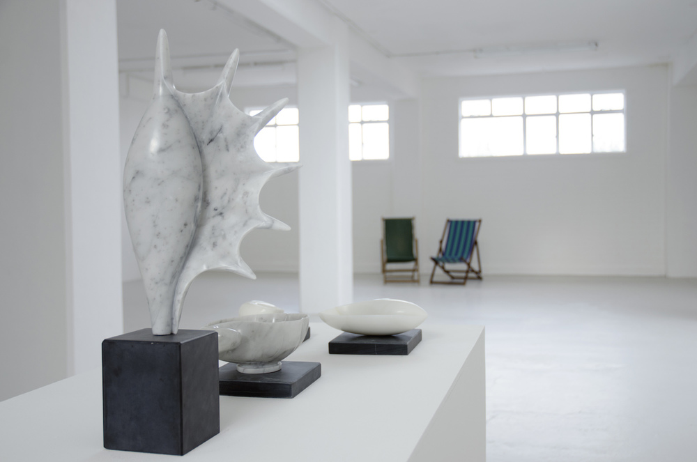 Installation view, [foreground] Edward Stein,  Conch,  2013, 28 x 23 x 7.5 cm, Carrara marble
