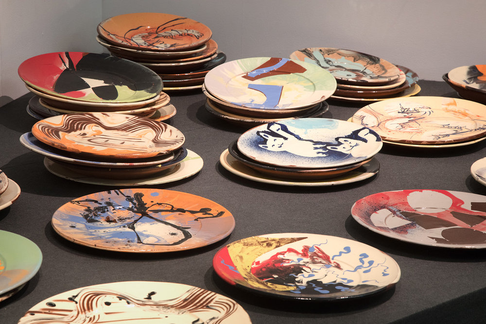 Fifty Slipware Plates (coming out as a potter) , 2017, earthenware, slips, transparent glaze, Exeter Phoenix, photo Jamie Woodley