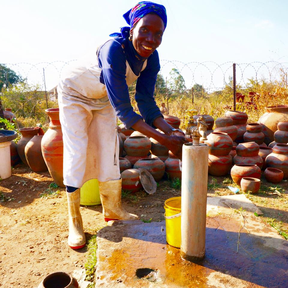 Marta collects water from the Mukondeni Factory borehole that PureMadi installed. Boreholes are the primary source of water for villagers, who often have to walk miles to collect it. Using PureMadi filters, a family is ensured safe drinking water.