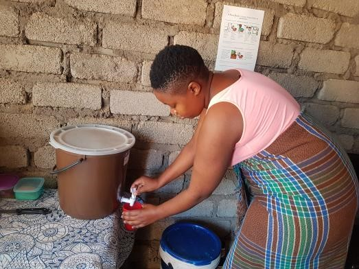 Dimakatso, one of the participants in the study, fetches drinking water from a ceramic water filter donated by PureMadi