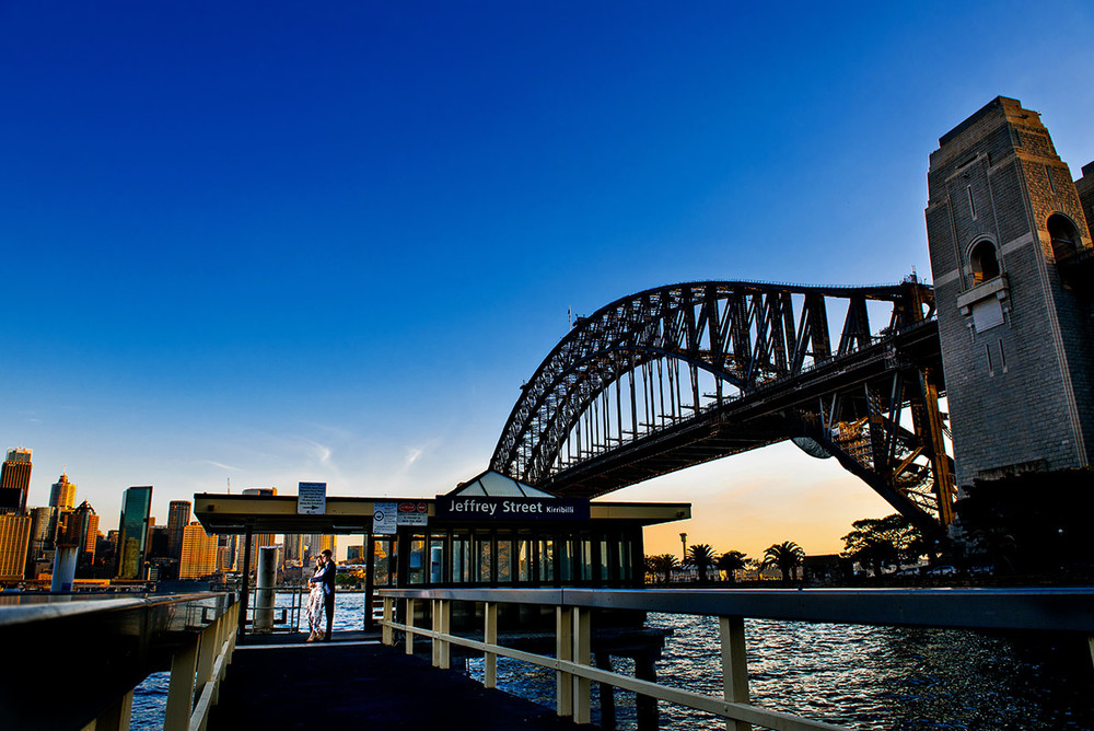 Couple together under Sydney Harbour Bridge
