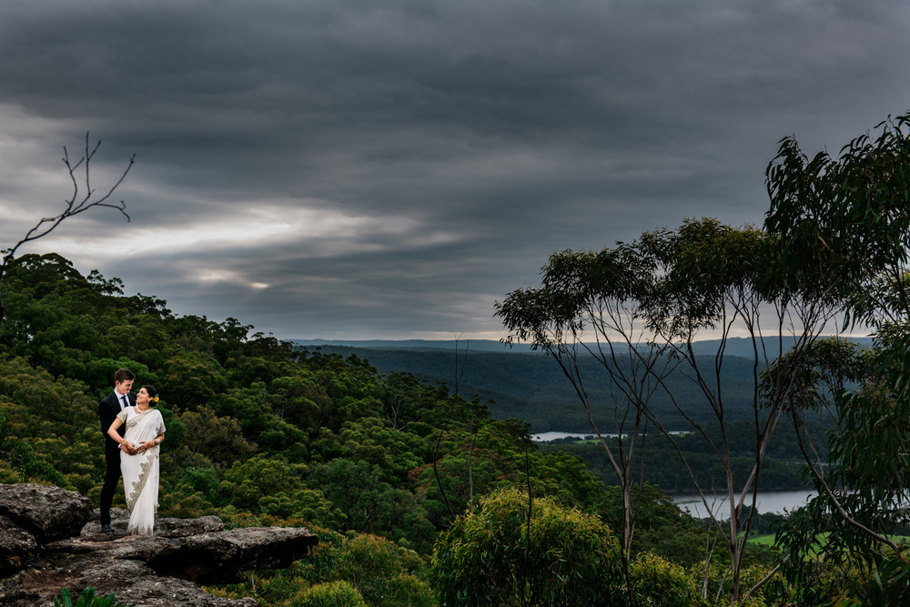 Couple pose with beautiful Shoalhaven views - Kangaroo Valley Bush Retreat wedding