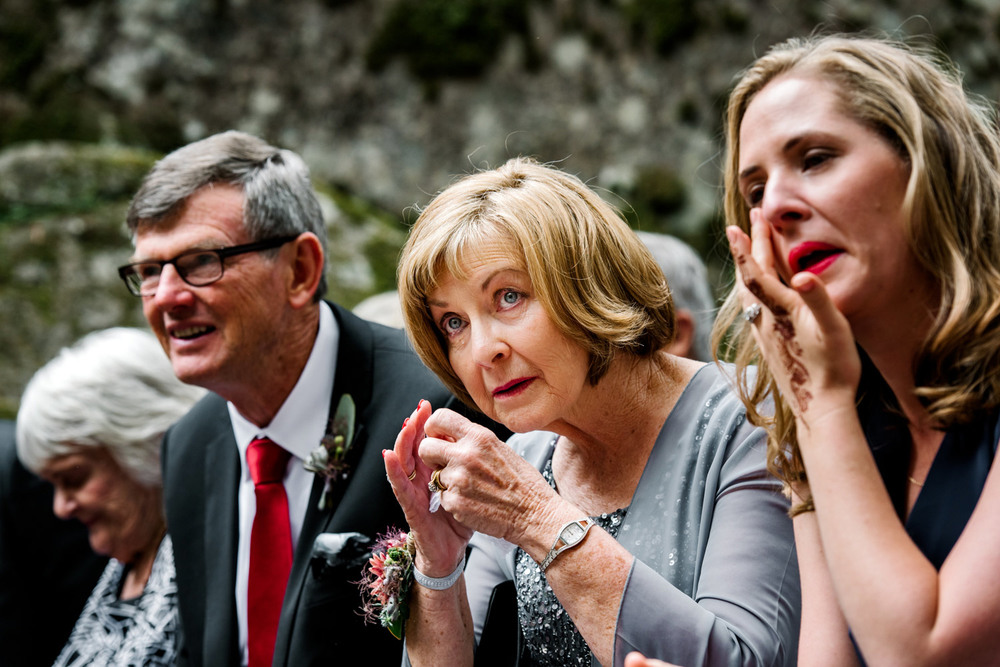 Emotional family look on during ceremony in Kangaroo Valley