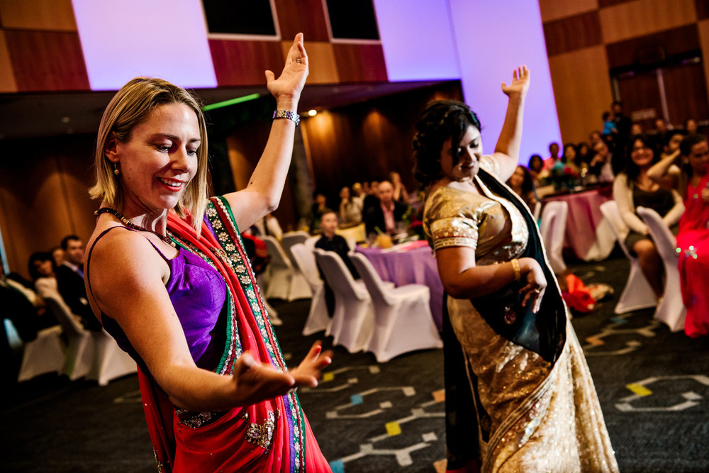 Indian dancing at traditional wedding party