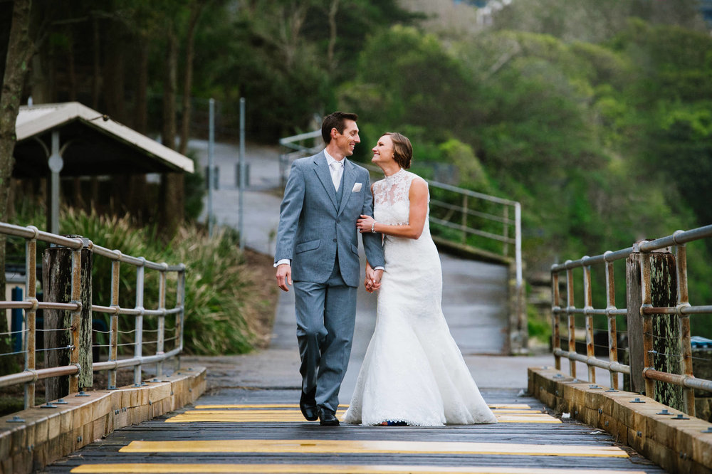 Bride and groom walking Little Manly Beach