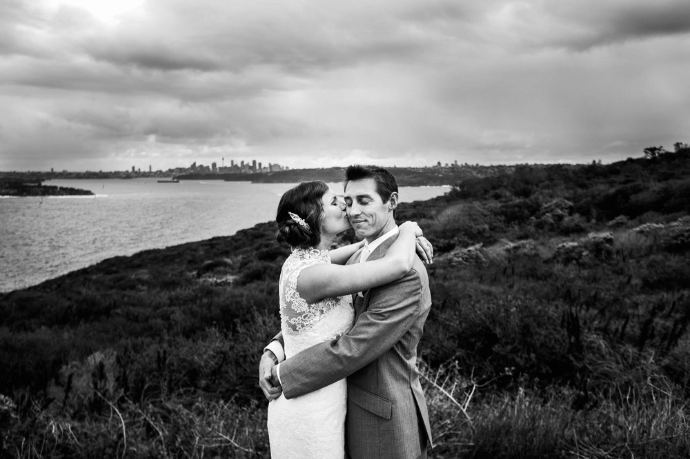 Milestone Events - wedding couple embrace at lookout.jpg