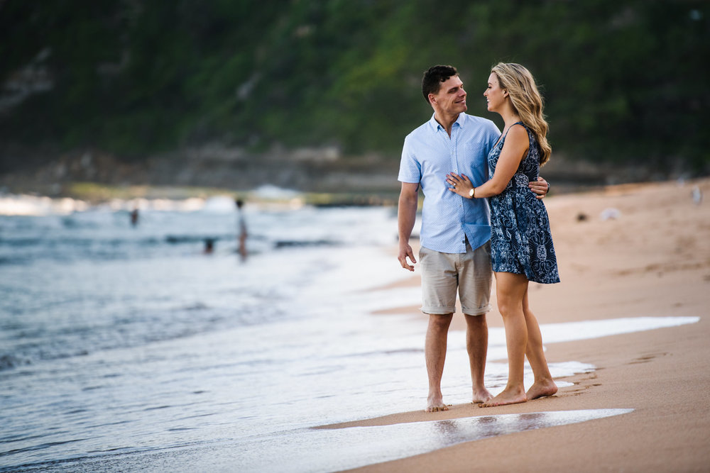 Engaged couple on the shore
