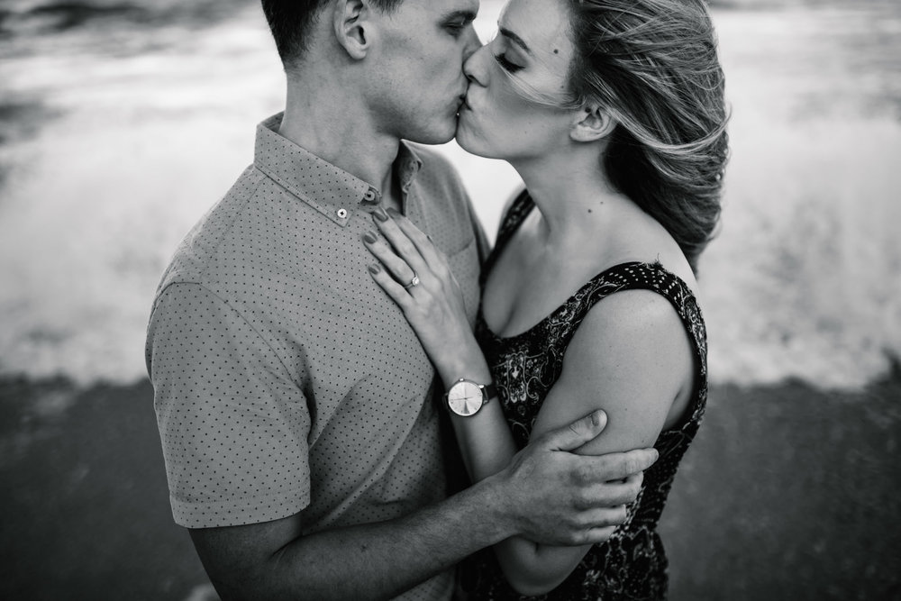 Engaged couple kissing