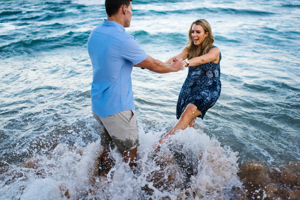 Engaged couple in the ocean