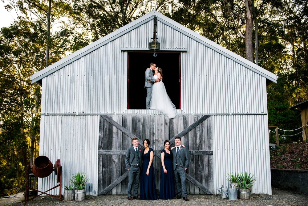 Greenfield Farm Estate bride and groom in the barn above wedding party