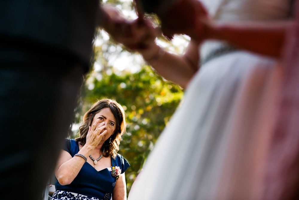 Mother wipes away tears watching her daughter get married at Greenfield Farm Estate
