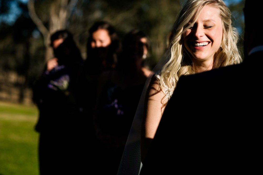 Bride smiles during wedding ceremony