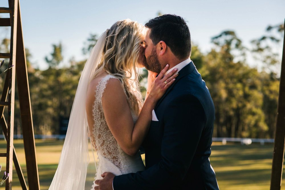 First kiss during Hunter Valley wedding ceremony
