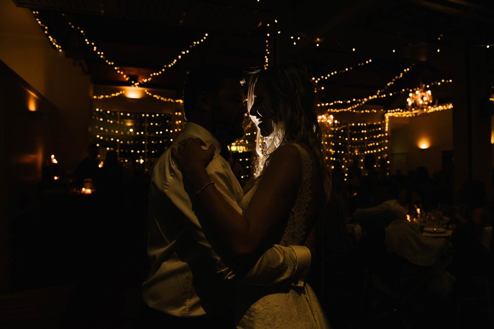 Silhouette of bride and groom during first dance