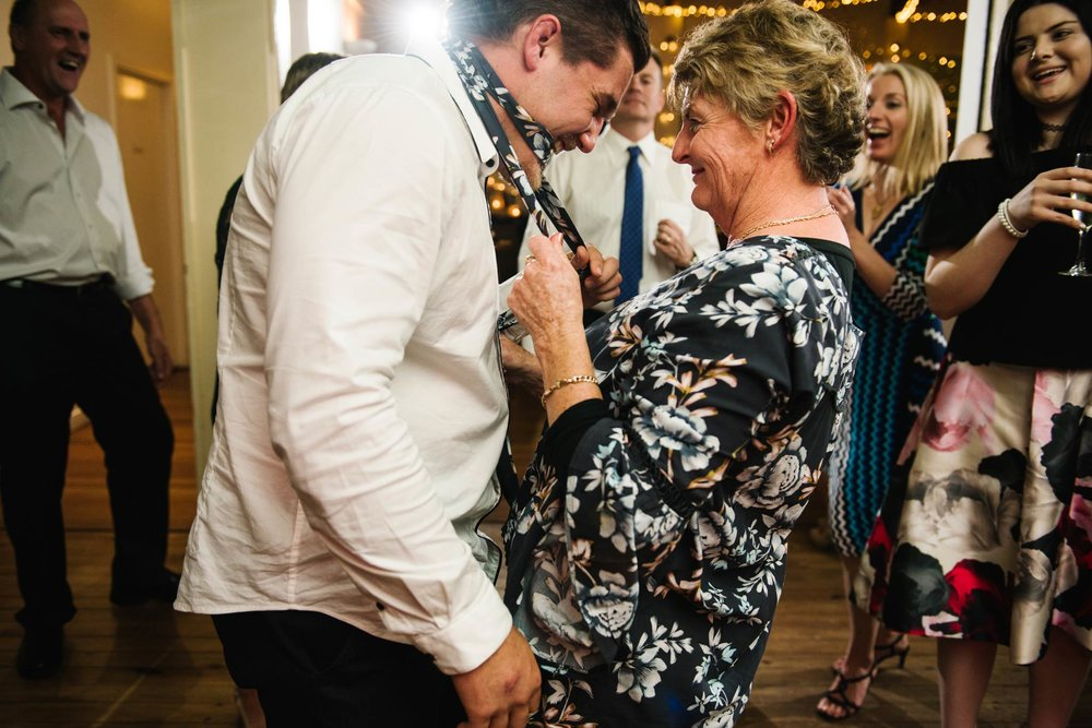 Aunt dirty dancing with guest at wedding