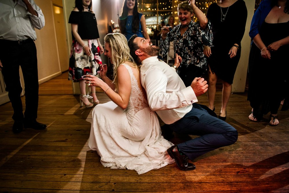 Bride and groom dancing back to back and laughing at Wandin Valley Estate reception