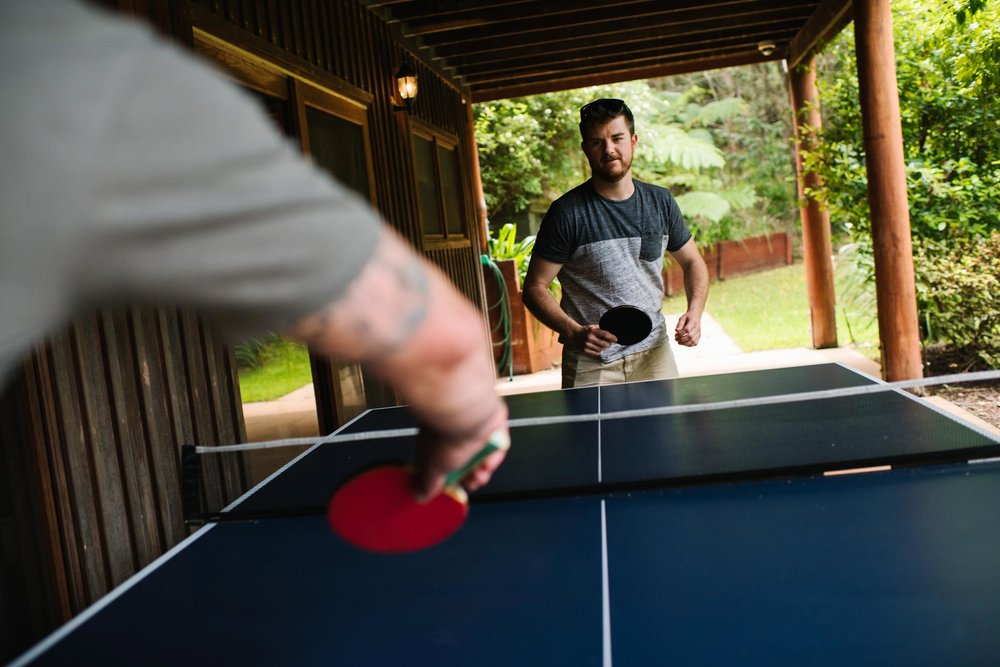 Groom playing table tennis before wedding