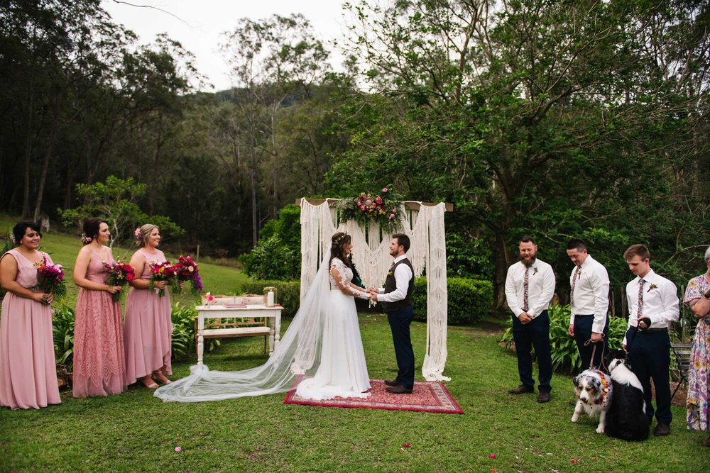 Rustic wedding ceremony with macrame altar