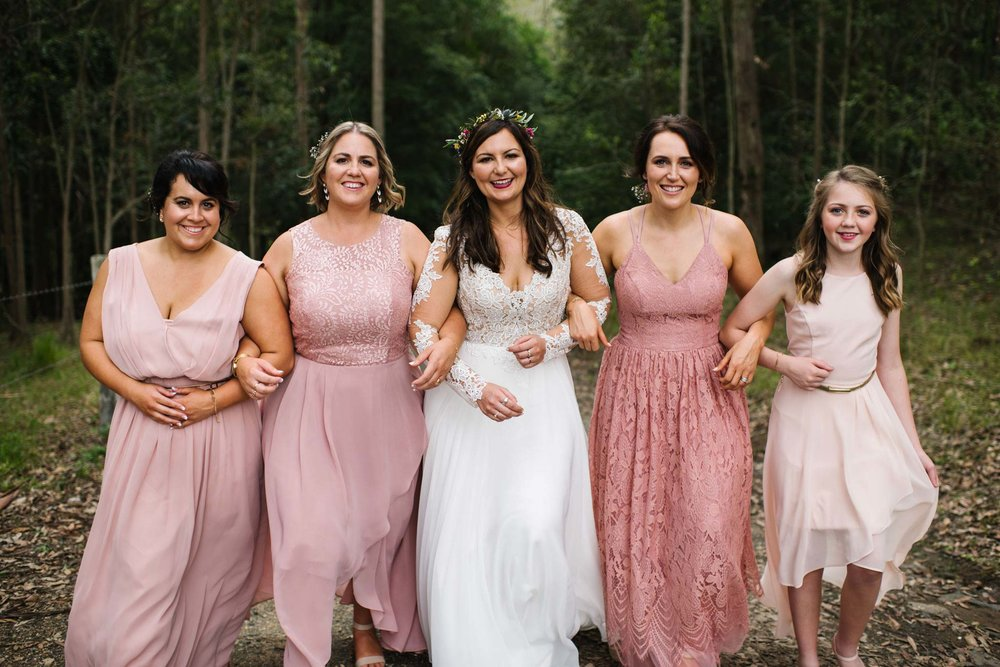 Bride and bridesmaids in various shades of pink