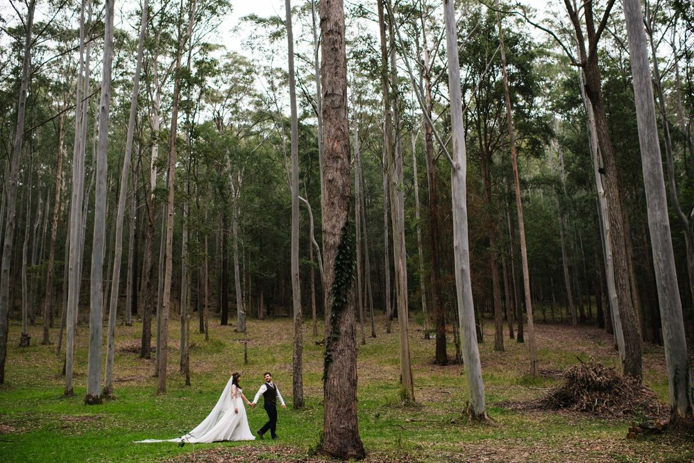 Newlyweds walk through the forest in country NSW
