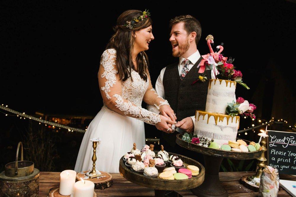 Whimsical wedding cake with flamingo topper