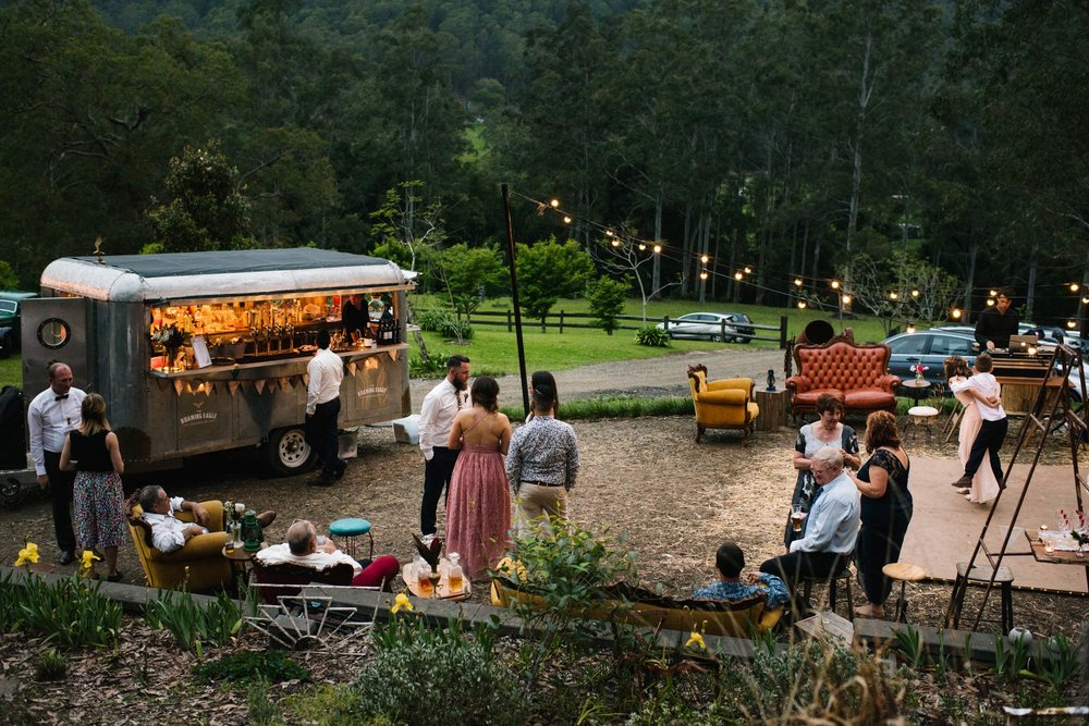 Outdoor wedding reception with festoon lights