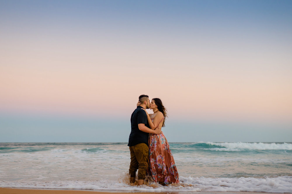 Couple kissing at sunset on the beach during engagement session on Sydney's Northern beaches