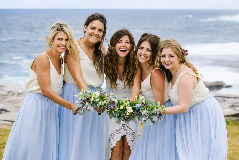 Bridesmaids in blue and white beachy dresses