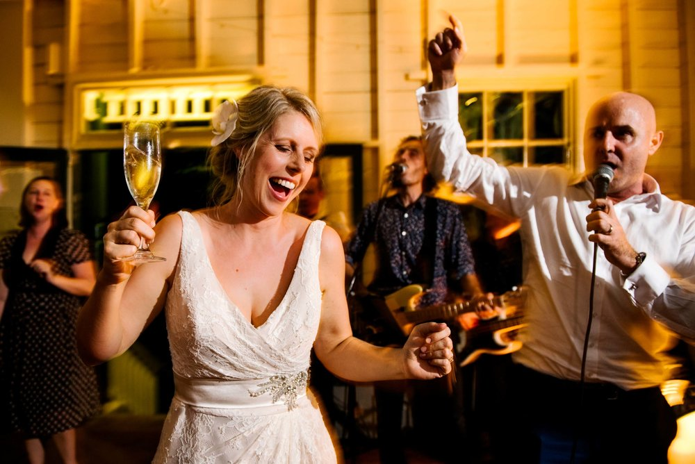 Groom singing to bride on dance floor at Athol Hall wedding