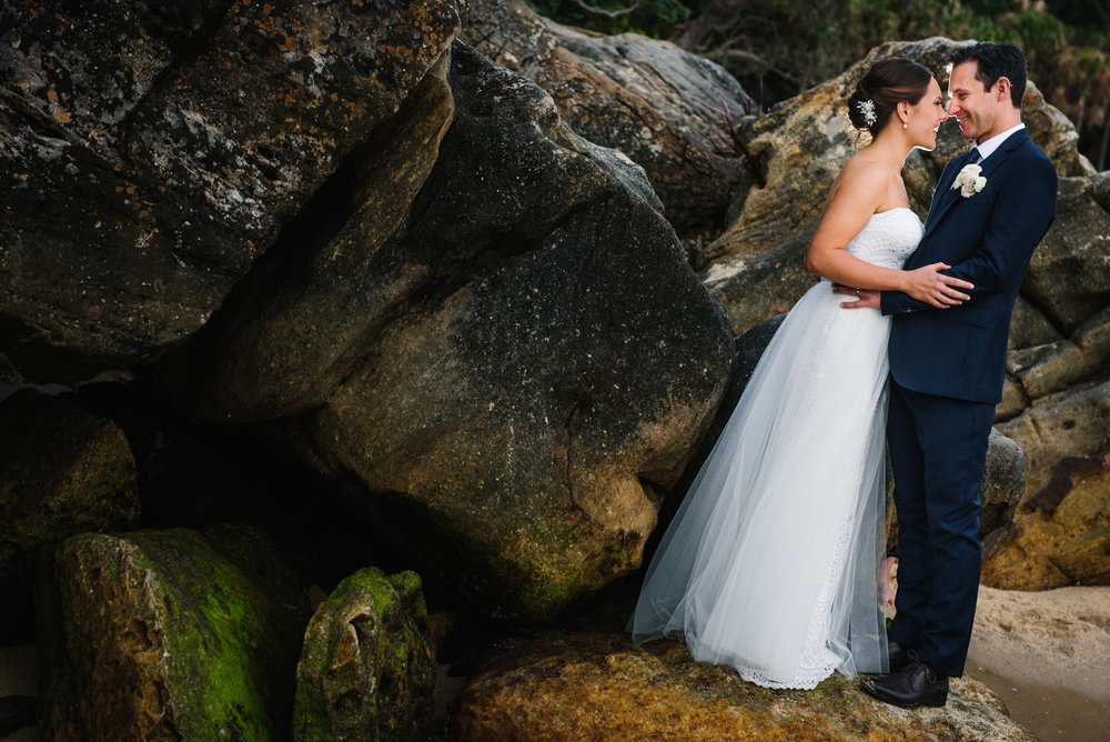 Bride and groom with rocks in the backdrop