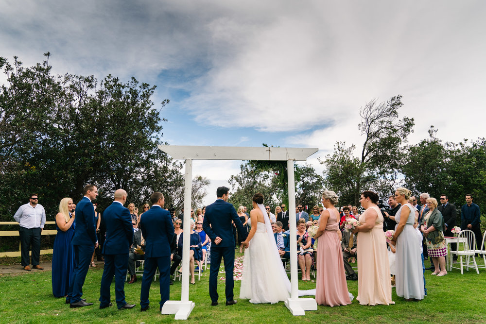 View of wedding ceremony at Shelly Beach headland