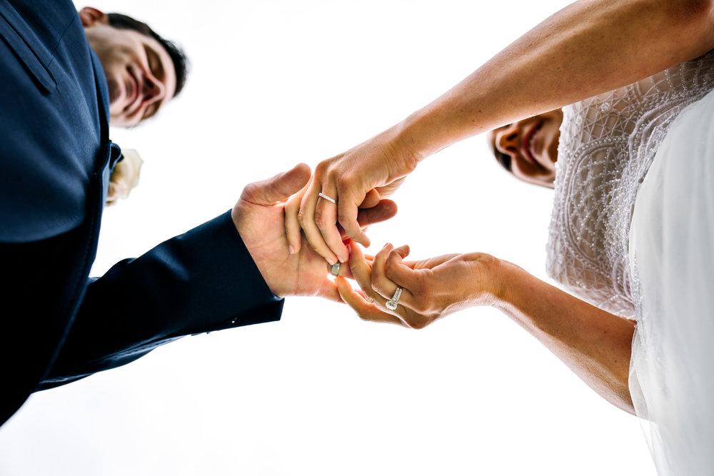 Bride and groom exchange rings, view from below