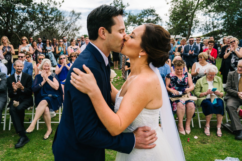 First kiss at Shelly Beach Manly wedding