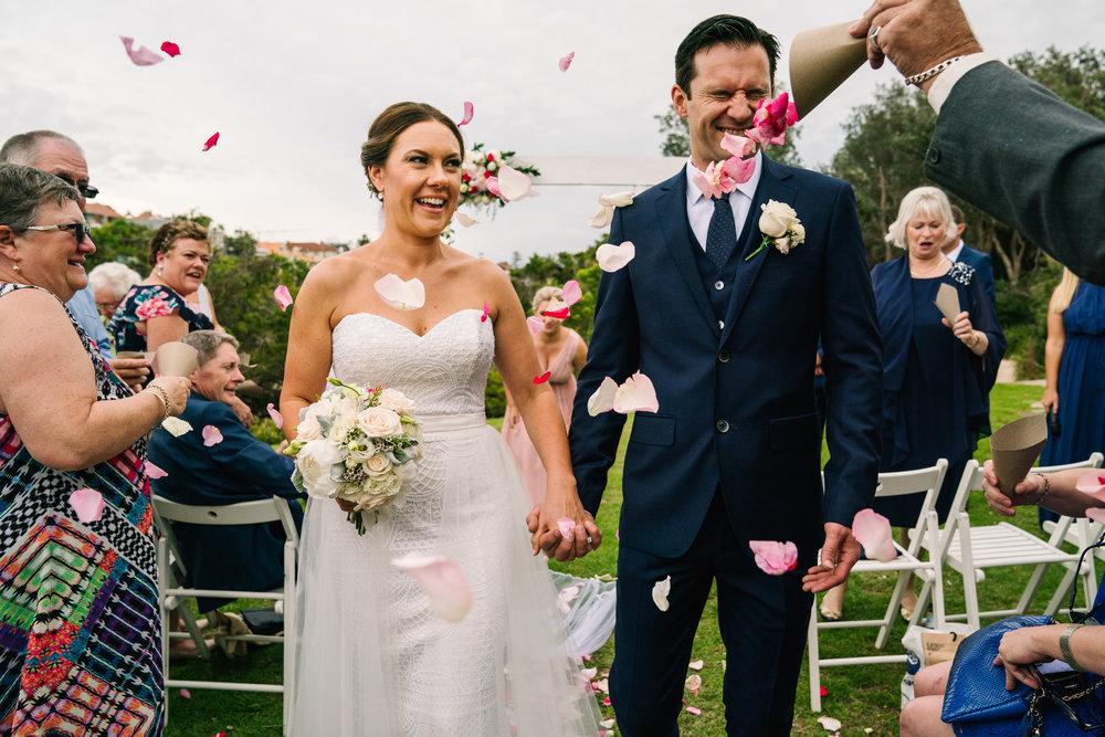 Flower petals being thrown in groom's face