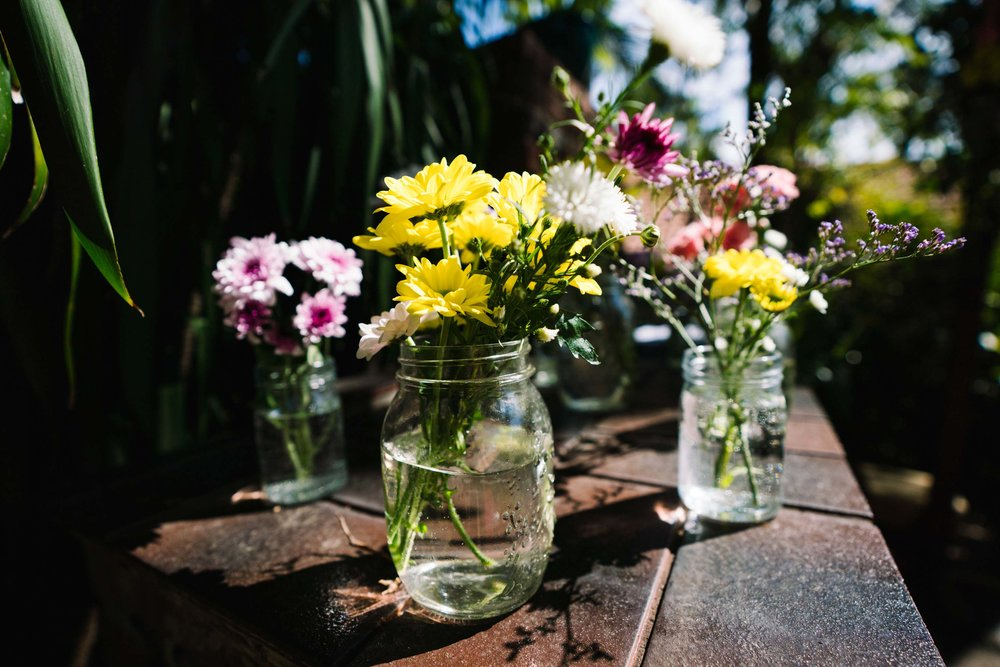 Daisies in mason jars wedding decoration