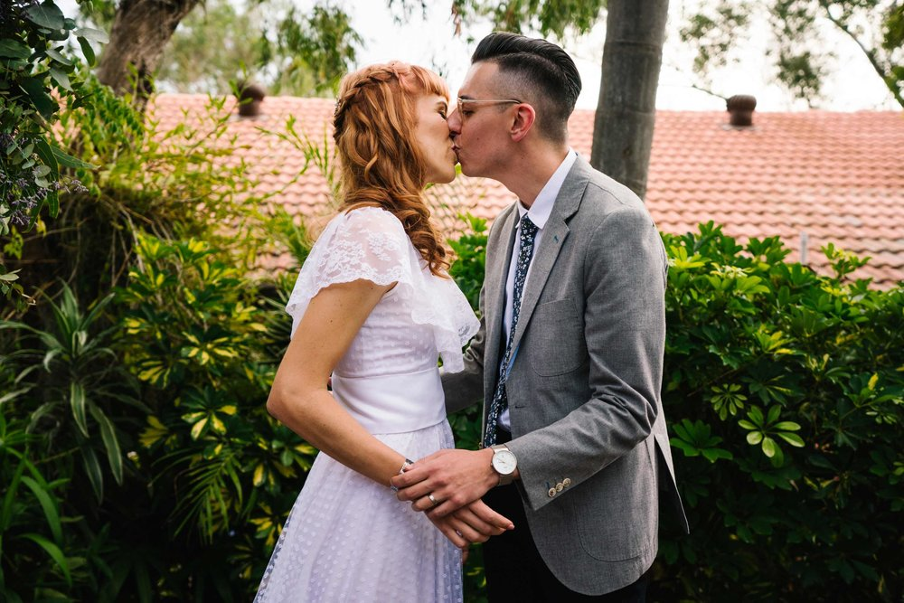 First kiss at hipster wedding ceremony